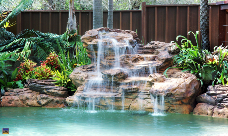Swimming pool rock waterfalls kits fountains and boulders for Pool waterfall