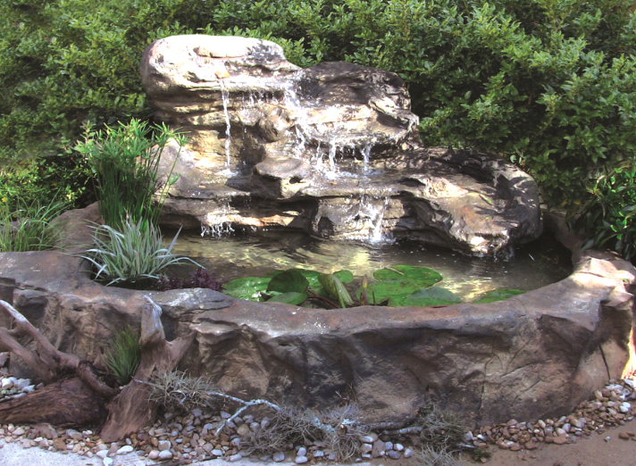 Swimming pool rock waterfalls and fountains add value to your home.  Swimming pool rock waterfalls